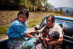 An indigenous woman with her two children, at right, and her mother, left, leave their village to the next town to register complaints of physical abuse by her husband, on March 28, 2012.<br />