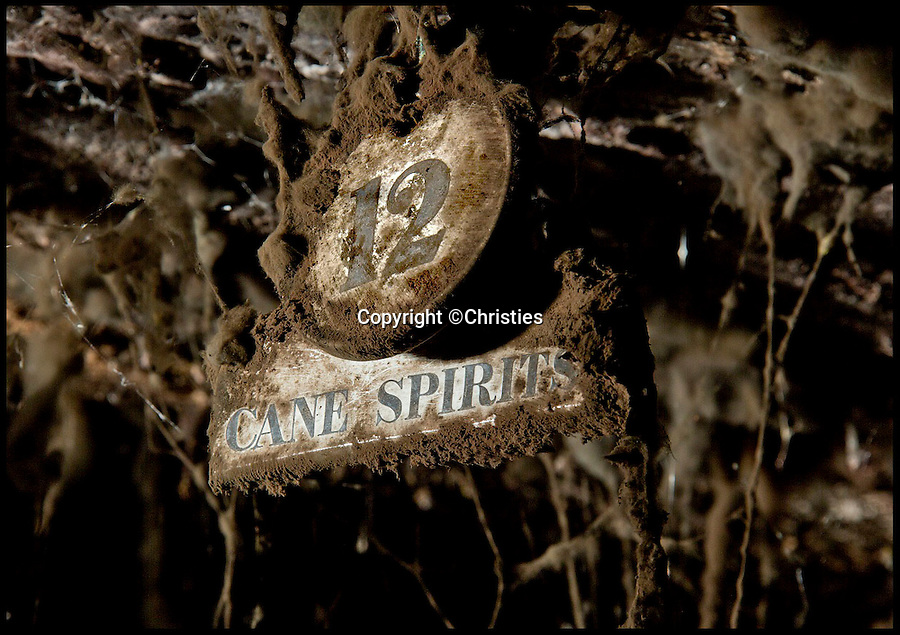 BNPS.co.uk (01202 558833)<br /> Pic: Christies/BNPS<br /> <br /> ***Please Use Full Byline***<br /> <br /> 12 cane spirits. <br /> <br /> Sixteen mouldy bottles of the world's oldest rum have sold for a whopping &pound;135,000 after they were discovered in the cellars of an British stately home.<br /> <br /> The rum was made in Barbados 235 years ago then brought back to Britain, where it was a popular spirit in Georgian times, by aristocrat Henry Lascelles, the Earl of Harewood.<br /> <br /> Amazingly the dust-covered bottles were only discovered in 2011, when Mark Lascelles, brother of the eighth Earl of Harewood, performed a stock check at the Grade II-listed property in Leeds.<br /> <br /> The sale means each bottle of rum is worth &pound;8,482, making it not only the oldest but also the most expensive rum in the world.