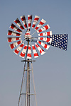 A patriotic red, white, blue painted Aermotor windmill on the plains in western Kansas.