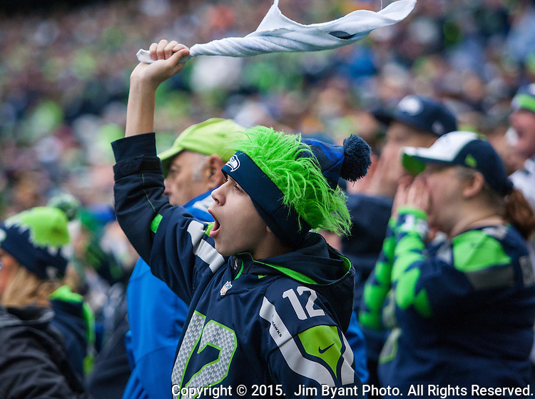 A Seattle Seahawks fan waves a towel and cheers for the Seahawks during the NFC Championship game against  the Green Bay Packers at CenturyLink Field in Seattle, Washington on January 18, 2015.  The Seattle Seahawks beat the Green Bay Packers in overtime 28-22 for the NFC Championship Seattle  ©2015. Photo by Jim Bryant. All Rights Reserved.