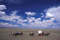 Covered Wagon, Trail riding,  Sagebrush Prarie, Oregon trail near Lander, Wyoming, USA