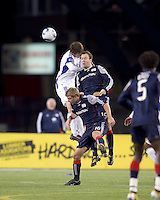 Kansas City Wizards defender Matt Besler (5), New England Revolution forward Zack Schilawski (15), and New England Revolution midfielder Jason Griffiths (16) battle for head ball. The New England Revolution defeated Kansas City Wizards, 1-0, at Gillette Stadium on October 16, 2010.