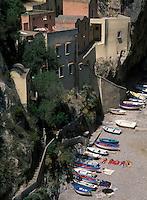 Boats and sun bathing on beach, Furore, Amalfi Coast, Italy