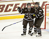 Katelyn Landry (Brown - 13) and Jenna Dancewicz (Brown - 14) celebrate Landry's goal which finished the scoring in the game. - The Boston College Eagles defeated the visiting Brown University Bears 5-2 on Sunday, October 24, 2010, at Conte Forum in Chestnut Hill, Massachusetts.