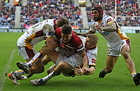 Wigan Warriors' Anthony Gelling stopped just short of the try line by Huddersfield Giants' Alex Mellor (left) and Ryan Hinchcliffe (right) <br /> Photographer Stephen White/CameraSport<br /> <br /> Betfred Super League Round 5 - Wigan Warriors v Huddersfield Giants - Sunday 19th March 2017 - DW Stadium - Wigan<br /> <br /> World Copyright &copy; 2017 CameraSport. All rights reserved. 43 Linden Ave. Countesthorpe. Leicester. England. LE8 5PG - Tel: +44 (0) 116 277 4147 - admin@camerasport.com - www.camerasport.com