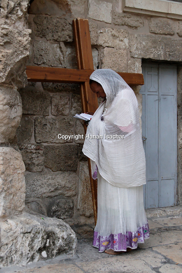 An Ethiopian pilgrim in front of the Church of the Holy Sepulchre on Holy Saturday, Easter 2006<br />