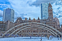 Outdoor ice skating at the Toronto City Hall outdoor rink with the Old City Hall in the background.