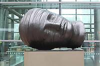 Testa Addormentata, by Igor Mitoraj, bronze, 1993, in Canary Wharf, West India Docks on the Isle of Dogs, Borough of Tower Hamlets, East London, UK.