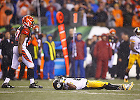 Antonio Brown #84 of the Pittsburgh Steelers lays on the ground after being hit by Vontaze Burfict #55 of the Cincinnati Bengals in the fourth quarter during the Wild Card playoff game at Paul Brown Stadium on January 9, 2016 in Cincinnati, Ohio. Brown would leave the game with a concussion. (Photo by Jared Wickerham/DKPittsburghSports)