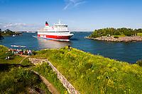 Finland, Helsinki. Suomenlinna sea fortress. Viking Line ferry passing through the Kustaanmiekka strait after leaving Helsinki for Stockholm.