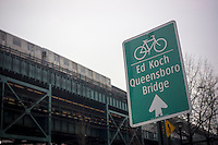 Signage directs bicyclists to the bike lane on the Ed Koch-Queensboro Bridge in Long Island City in Queens in New York on Saturday, February 2, 2013.  (© Richard B. Levine)