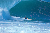 Two times world surfing champion TOM CARROLL (AUS) snaps under the lip during the running of the 1991 Marui Pro at Pipeline, North Shore ,Oahu, Hawaii. This one manoeuvre  redefined the way people surf the infamous Banzi Pipeline  . Photo: joliphotos.com
