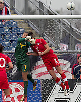 Canadian defender  Emily Zurrer (2) collides with Brazilian goalkeeper Andreia (1), who was injured on the play and left the match. In an international friendly, Canada defeated Brasil, 2-1, at Gillette Stadium on March 24, 2012.