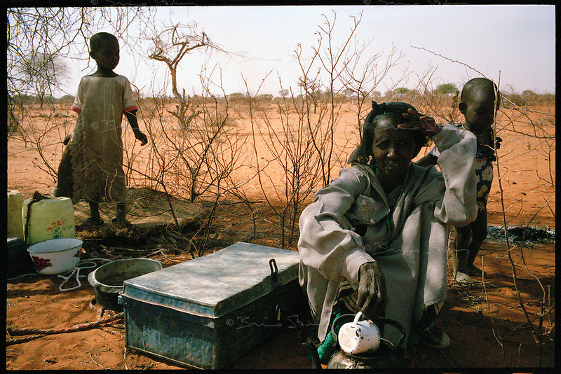Near 'Bore Hole 11', NE Kenya, March 2006.Alima Mali Saad, with her daughter Faduma Ibrahim, 5, left, and her infant son Chakri Ibrahim are 'drop-outs', semi-nomadic herdsmen who left the bush to come and live in camps near villages, abandonning their traditional lifestyle...