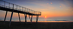 A glorious sunrise over the calm waters of the Adriatic Sea. Taken on a mild morning of January from the beach of the Lido in Venice, Italy, this is stitched from nine vertical frames.