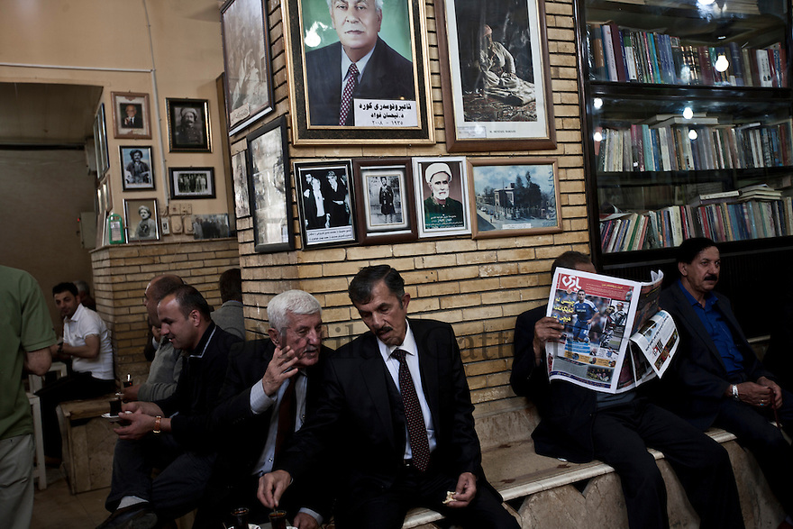 Iraq - Kurdistan - Sulaymaniyah -   Men sitting and chatting in Cafe' Shab known for gathering artists and intellectuals