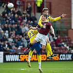 Hearts v St Johnstone....06.05.12   SPL.Murray Davidson gets above Ian Black.Picture by Graeme Hart..Copyright Perthshire Picture Agency.Tel: 01738 623350  Mobile: 07990 594431