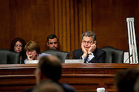Senator Al Franken  (D-Minn.) listens to opening remarks during a Senate Judiciary subcommittee hearing on the proposed AT&T/T-Mobile merger on Wednesday, May 11, 2011  in Washington.  (Photo by Jay Westcott/Politico)