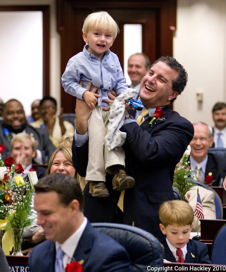 TALLAHASSEE, FLA. 11/16/10-ORG.SESS111610HACKLEY20-in a light-hearted moment Rep. Jimmy Patronis, R-Panama City, lifts his son Jimmy Theo Patronis III up after Jimmy III spoke during a voice vote during Organizational Session of the Legislature Tuesday at the Capitol in Tallahassee...COLIN HACKLEY PHOTO