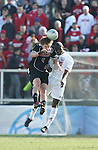 New Mexico's Jeff Rowland (6) and Maryland's Maurice Edu (10) challenge for a header. The University of Maryland Terrapins defeated the University of New Mexico Lobos 1-0 in the Men's College Cup Championship game at SAS Stadium in Cary, NC, Friday, December 11, 2005.