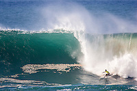 Waimea Bay, North Shore, Oahu, Hawaii December 15 2004.<br /> Andy Irons (Haw) - The 2004 Quiksilver Eddie Aikau Big Wave Invitational won by Hawaiian surfer Bruce Irons (HAW) from the island of Kauai was held in 30 to 40' waves at Waimea Bay on the North Shore of Oahu Hawaii, today, December 15th 2004. Irons rode one of the biggest waves of the day which was at least 30' in height, taking home US$55,000 in prize money.  Photo: Joliphotos.com