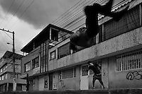 Colombian parkour athletes from Plus Parkour team do a front flip as they practise free running on the street in Bogotá, Colombia, 22 February 2016. Parkour, originally developed in France during the late 1980s from military training, is a physical activity, focused on the art of movement and overcoming obstacles in a strictly urban environment. Practitioners of parkour employ running, climbing, jumping, rolling and other movements to pass through any urban area the most efficient way possible.