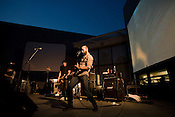 July 12, 2008. Durham, NC..Post punk heros, Les Savy Fav, played their first show in 4 years in the Triangle at Duke's Nasher Museum of Art. Incorporating live video of the crowd, the band played to a appreciative crowd.