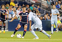 Benny Feilhaber (22) New England midfielder faces Julio Cesar Sporting KC... Sporting Kansas City defeated New England Revolution 3-0 at LIVESTRONG Sporting Park, Kansas City, Kansas.