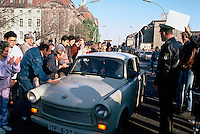 East Germans are welcomed as they drive their Trabant into West Berlin, on the morning of November 10, 1989, hours after the opening of the Berlin Wall.