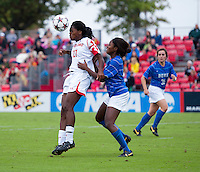Hayley Brock (27) of Maryland heads the ball in the box in front of Natasha Anasi (4) of Duke at Ludwig Field on the campus of the University of Maryland in College Park, MD. DC. Duke defeated Maryland, 2-1.