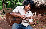 Javier Duarte tuning a 5-string guitar in the Guarani village of Andresito near San Ignacio, Misiones, Argentina.