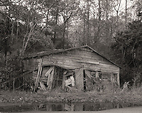 This nearly collapsed building appears to have been once a home and possibly a storage building later on. It is located in the old section of Dorchester town, just off Rt. 78