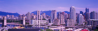 "Burrard Street Bridge and City of Vancouver Skyline and Downtown at Granville Island and ""False Creek"", BC, British Columbia, Canada, in Summer.  The North Shore Mountains (Coast Mountains) rise above the City. - Panoramic View"