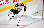 22 April 2009: Boston Bruins' center David Krejci carries the puck around his net during the first period against the Montreal Canadiens at the Bell Centre in Montreal, Quebec, Canada. The Bruins advance to the Eastern Semi-Finals, eliminating the Canadiens from Stanley Cup competition with their 4-1 win and series sweep. ***** Editorial Sales Only ***** Mandatory Credit: Ed Wolfstein Photo