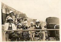 BNPS.co.uk (01202 558833)<br /> Pic: RichardCrease/BNPS<br /> <br /> Gillian's mother (right) with her parents at the hut in 1934.<br /> <br /> Beach hut owners fury after sea views are blocked...by more beach huts.<br /> <br /> Irate beach hut owners have slammed a council who have allowing a row of beach huts to be built directly in front of them blocking their beautiful sea views.<br /> <br /> Owners who pay &pound;1,094 a year to the council to have a beach hut there will instead have to make do with the view of the back of another beach hut.<br /> <br /> Furious owners in the Manor Steps area in Bournemouth, Dorset, are demanding action after being told of plans to place more huts between them and the beach by the end of the month.<br /> <br /> They claim their views of the sea, beach and prom will be completely blocked and that the council has not consulted them on the plans.<br /> <br /> Bournemouth Borough Council said the move is necessary to allow for the creation of a turning circle for the newly-routed land train.<br /> <br /> Mrs Vincent, who has owned a beach hut for more than 50 years, said: &quot;What's the point of owning a beach hut if all you can see is the back of another hut?
