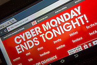 The Macys website features cyber monday sales on Monday, December 2, 2013. While many retailers are offering specials online for CyberMonday, the so-called holiday dates back when most Americans had no broadband and limited internet access so they would shop on the first day back at work, using their employers faster internet. Now everyone shops online all year. (© Richard B. Levine)