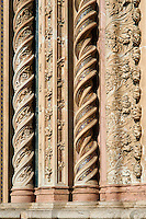 Medieval sculpted decorative columns on the14th century Tuscan Gothic style facade of the Cathedral of Orvieto, designed by Maitani, Umbria, Italy