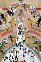 Customers browse counters to buy electronics goods in Xujiahui shopping mall, in Shanghai, China, on February 1, 2009. Photo by Lucas Schifres/Pictobank