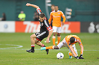 Houston Dynamo midfielder Boniek Garcia (27) goes against D.C. United defender Chris Korb (22) D.C. United tied The Houston Dynamo 1-1 but lost in the overall score 4-2 in the second leg of the Eastern Conference Championship at RFK Stadium, Sunday November 18, 2012.