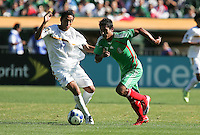 Marlon Medina (18) and Alberto Medina (7) battle for the ball. Mexico defeated Nicaragua 2-0 during the First Round of the 2009 CONCACAF Gold Cup at the Oakland, Coliseum in Oakland, California on July 5, 2009.
