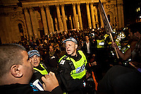 Police officer - 2011<br /> <br /> London, 15/10/2011. St Paul's Square became the stage of the UK arm of the Occupy protest movement which has been growing around the world. The Occupy movement is a world-wide protest against the financial crises created by the actual financial system, by speculation, by deregulation, and by the actions of major international financial and investment banks. Around 2,000 protesters armed with tents and placards, gathered outside the famous Cathedral intending to occupy Paternoster Square, home of the London Stock Exchange and the heart of the City of London, but they were hampered by City police officers. After this failed attempt the protesters decided to camp in front St Paul's where the situation with police forces became immediately tense. Masked like the character of Guy Fawkes from the movie &quot;V for Vendetta&quot;, Julian Assange appeared on the square to give a speech in support of the protesters. During the late evening police forces heavily armed with riot control equipment charged the square, attempting to evict the occupants who resisted. Later in the evening the police retreated and the occupation continued peacefully.