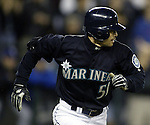 Seattle Mariners Ichiro Suzuki runs to first base after hitting a ball into center field which broke George Sisler's 1920 single season record of 257 in the third inning against the Texas Rangers on Friday, Oct., 1, 2004 at Safeco Field in Seattle. Suzuki has three hits in the game raising his single season total to 259. Jim Bryant Photo. ©2010. ALL RIGHTS RESERVED.