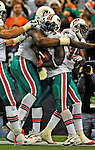 7 December 2008: Miami Dolphins' running back Ricky Williams is greeted by teammates in the end zone during the first regular season NFL game ever played in Canada. The Dolphins defeated the Buffalo Bills 16-3 at the Rogers Centre in Toronto, Ontario. ..Mandatory Photo Credit: Ed Wolfstein Photo