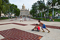Boys playing with cart in front of Capital.
