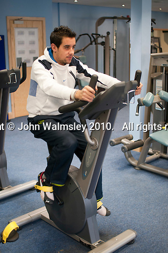 English as a Foreign Language student keeping fit in the college gym, Further Education College.