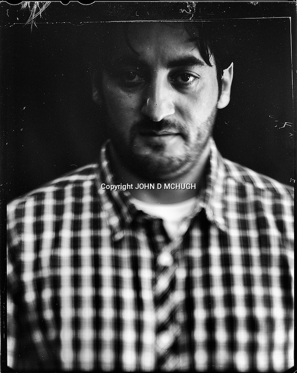 "Bashir Socyal, a university student, is seen in Kabul, 22 August 2012. This portrait was shot on a 5x4 Linhof Technika IV, circa 1959, and a Schneider Kreuznach 270mm lens, circa 1952, with front tilt, and is part of a series entitled ""Putting an Afghan face on the war."" (John D McHugh)"