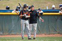 North Davidson Knights head coach Matt Griffin gives instructions to Austin Beck (23) during the game against the Alexander Central Cougars at Bob Gryder Stadium on March 25, 2017 in Taylorsville, North Carolina.  The Knights defeated the Cougars 3-0.  (Brian Westerholt/Four Seam Images)
