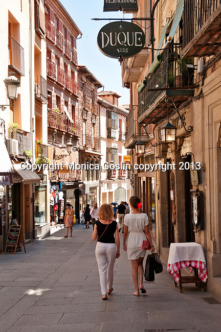 Shops and cafes on Calle Cervantes in Segovia, Spain