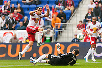 Fabian Espindola (9) of the New York Red Bulls jumps over Los Angeles Galaxy goalkeeper Carlo Cudicini (1) during a Major League Soccer (MLS) match at Red Bull Arena in Harrison, NJ, on May 19, 2013.