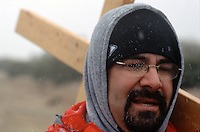Larry Corona, of Belen, N.M., carries a cross to the Santuário de Chimayó in northern New Mexico on Good Friday. Thousands of pilgrims make a pilgrimage to the 190-year-old shrine every Easter as an expression of faith, a connection to old Hispanic roots and in hopes of the miracles reputed to occur there.